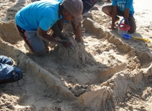 Team coming together to make huge sand castle